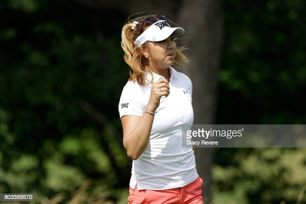 Alison Lee watches her tee shot on the fifth hole during the first round of the 2017 KPMG PGA Championship at Olympia Fields Country Club on June 29...