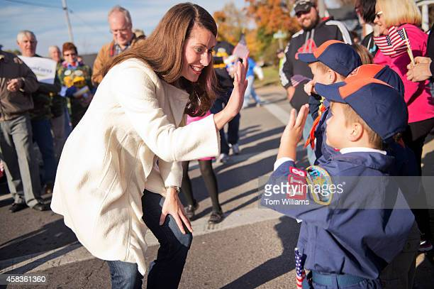 Alison Lundergan Grimes Democratic candidate for Kentucky Senate greets attendees of a veteran's parade in Madisonville Ky November 2 2014