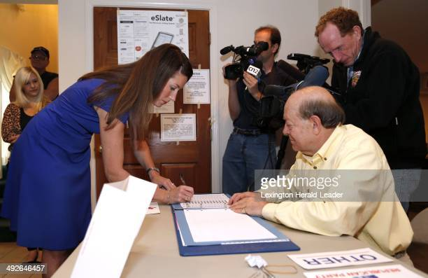 Alison Lundergan Grimes signs the election book in front of election official Fred Mills as she voted at Pleasant Green Baptist church in Lexington...