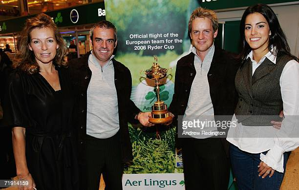 Alison McGinley Paul McGinley of Ireland Luke Donald of England and Diane Antonopoulos pose with the Ryder Cup Trophy as they arrive at Heathrow...