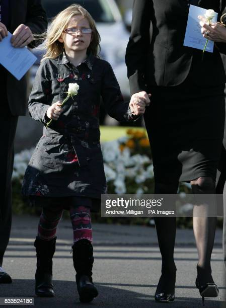 Alison McRae and daughter Holly leave the funeral of Colin McRae and son Johnny at East Chapel, Daldowie Crematorium.
