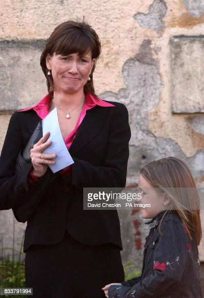 Alison McRae and her daughter Hollie are seen at the Service of Celebration for her husband Colin McRae and their son Johnny McRae taking place at St...