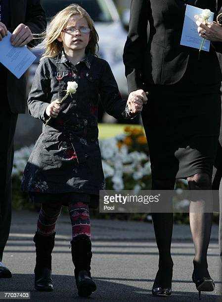 Alison McRae, wife of Colin McRae and daughter Holly McRae leave the funeral of Colin McRae and son Johnny at East Chapel, Daldowie Crematorium on...