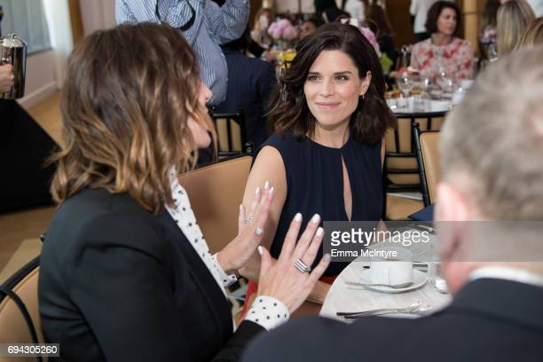 Alison Miller and actress Neve Campbell attend 'Los Angeles Confidential Women of Influence tea hosted by Neve Campbell' at Waldorf Astoria Beverly...