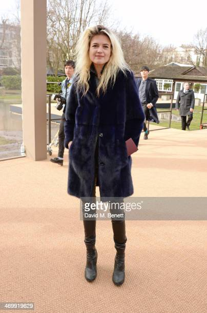 Alison Mosshart arrives at Burberry Womenswear Autumn/Winter 2014 at Kensington Gardens on February 17 2014 in London England