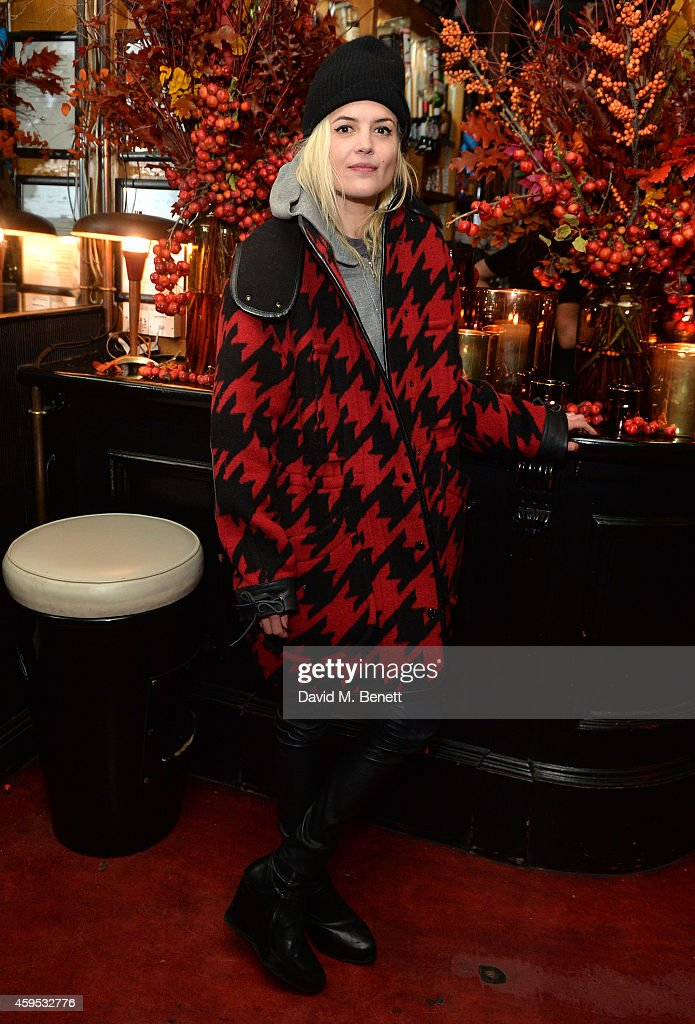 Alison Mosshart attends the Thanksgiving dinner with Coach hosted by Zoe Kravitz and Mary Charteris on November 24, 2014 in London, England.