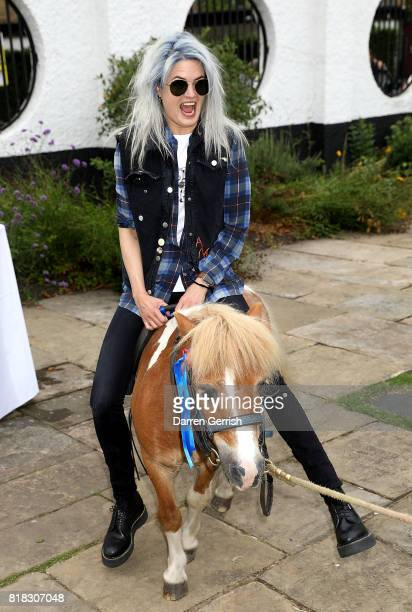 Alison Mosshart rides Freddie the Shetland pony at the J Brand x Bella Freud garden tea party on July 18 2017 in London England