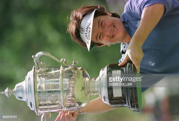 Alison Nicholas holds the Womens US Open trophy after her victory over US golfer Nancy Lopez during the trophy ceremony after the final round of the...