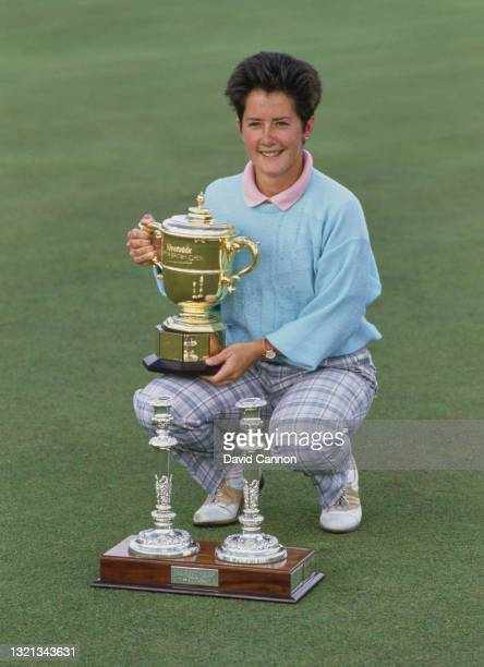 Alison Nicholas of Great Britain poses for photographs with the champion golfer trophy after winning the Weetabix Women's British Open golf...