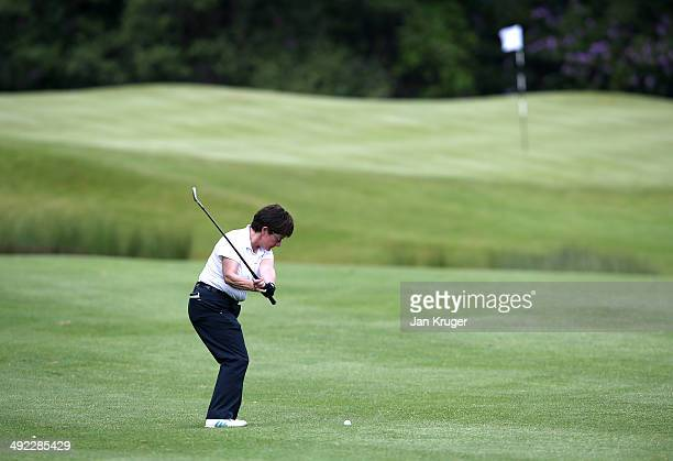 Alison Nicholas of Hagley GC plays an approach shot during the Glenmuir Women's PGA Professional Championship Qualifier at Little Aston Golf Club on...