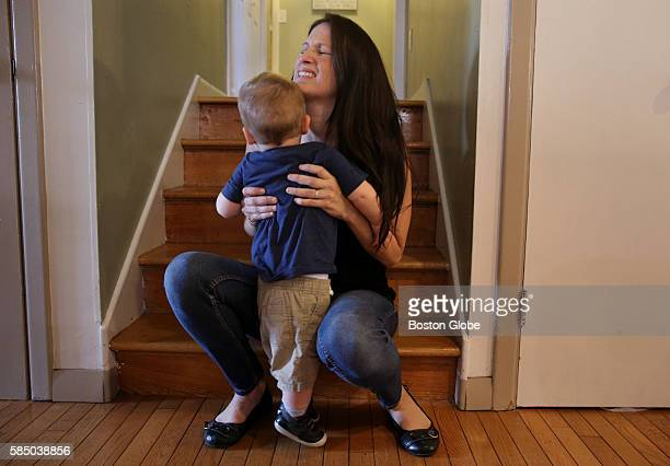 Alison Novak winces with pain as she lifts her 16monthold son Jace at her home in Johnston RI on July 06 2016 She says lifting her child is painful...