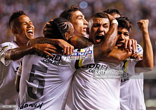 Alison of Santos and his teammates celebrate their second goal during the match between Santos and Palmeiras for the Brazilian Series A 2014 at Vila...