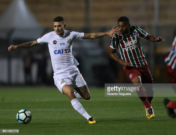 Alison of Santos battles for the ball with Wendel of Fluminense during the match between Santos and Fluminense as a part of Campeonato Brasileiro...