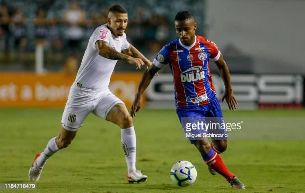 Alison of Santos vies the ball with Elber of Bahia during a match between Santos and Bahia for the Brasileirao Series A 2019 at Vila Belmiro Stadium...