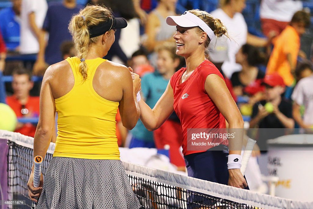 Alison Riske congratulates Caroline Wozniaki of Denmark after theirm match on day 2 of the Connecticut Open at Connecticut Tennis Center at Yale on August 25, 2015 in New Haven, Connecticut.