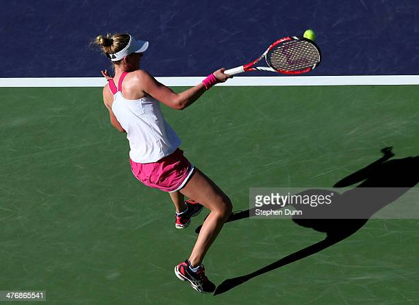 Alison Riske hits a return to Bojana Jovanovski of Serbia during the BNP Paribas Open at Indian Wells Tennis Garden on March 5 2014 in Indian Wells...