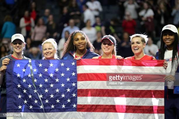 Alison Riske Kathy Rinaldi Serena Williams Sofia Kenin Bethanie MattekSands and Coco Gauff of USA pose for a photo while celebrating their win...