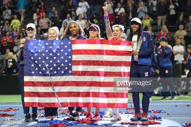 Alison Riske Kathy Rinaldi Serena Williams Sofia Kenin Bethanie MattekSands and Coco Gauff of USA pose for a photo while celebrating their win...