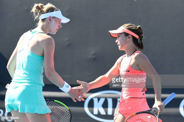 Alison Riske of the United States and Lauren Davis of the United States talk tactics in their first round women's doubles match against Dalila...