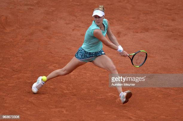 Alison Riske of The United States of America plays a backhand during her womens singles first round match against Simona Halep of Romania during day...