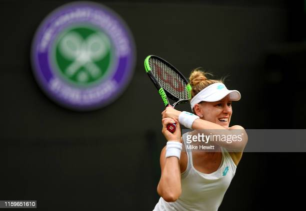 Alison Riske of The United States plays a backhand in her Ladies' Singles first round match against Donna Vekic of Croatia during Day two of The...
