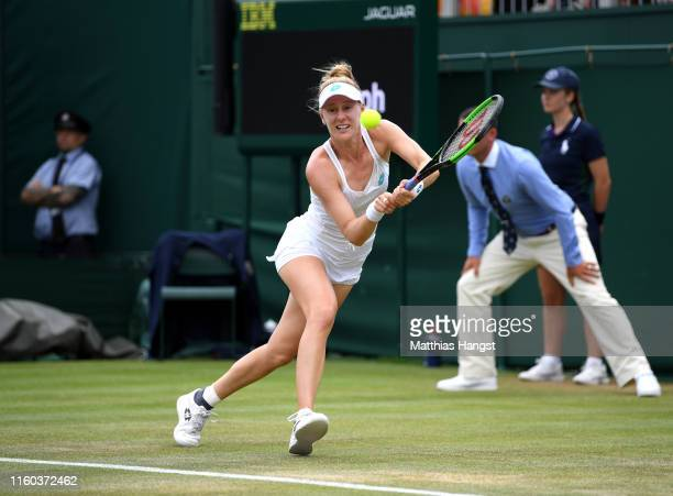 Alison Riske of The United States plays a backhand in her Ladies' Singles third round match against Belinda Bencic of Switzerland during Day six of...