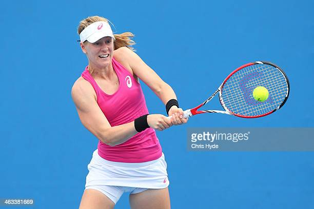 Alison Riske of the United States plays a backhand in her second round doubles match with Madison Keys of the United States against Kristina...