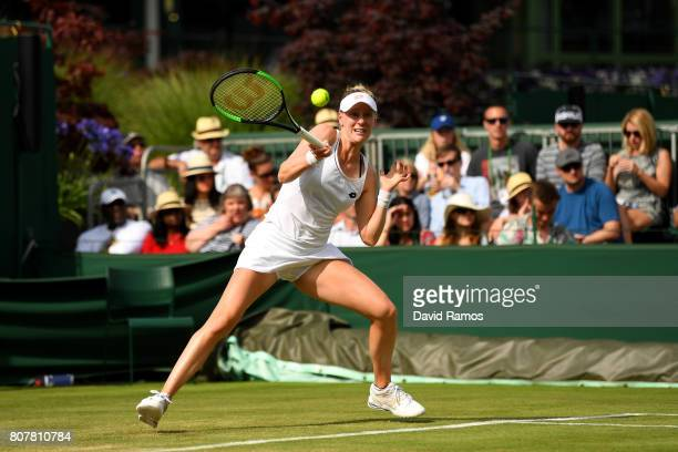Alison Riske of the United States plays a forehand during the Ladies Singles first round match against Sloane Stephens of The United States on day...