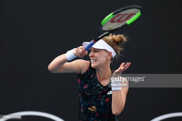 Alison Riske of the United States plays a forehand in her first round doubles match with partner Jennifer Brady of the United States against Astra...