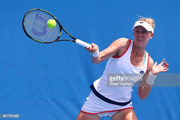 Alison Riske of the United States plays a forehand in her first round match against Oceane Dodin of France during day one of the 2015 Australian Open...
