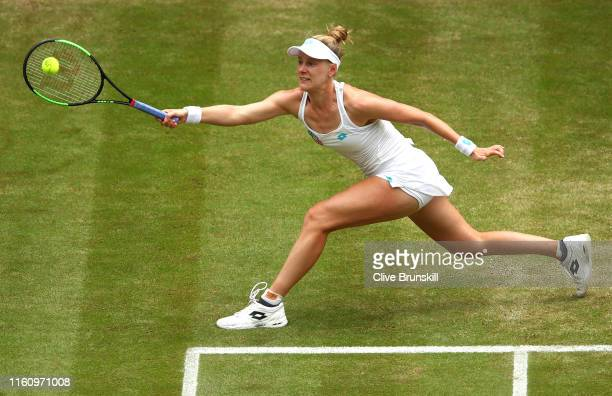 Alison Riske of the United States plays a forehand in her Ladies' Singles Quarter Final match against Serena Williams of the United States during Day...