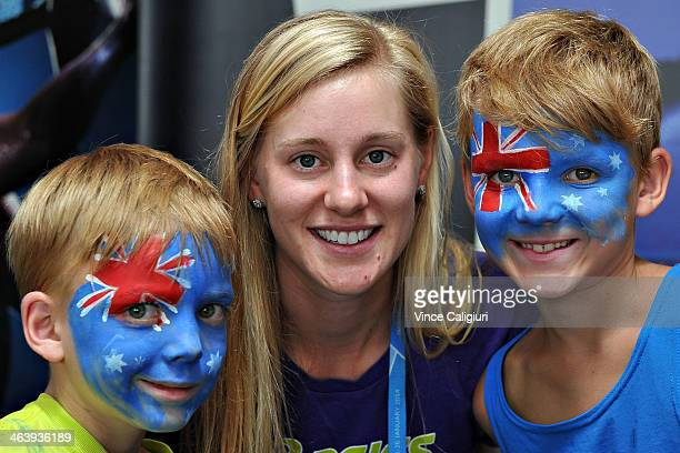 Alison Riske of the United States poses with aussie fans at the WTA booth during day 8 of the 2014 Australian Open at Melbourne Park on January 20...