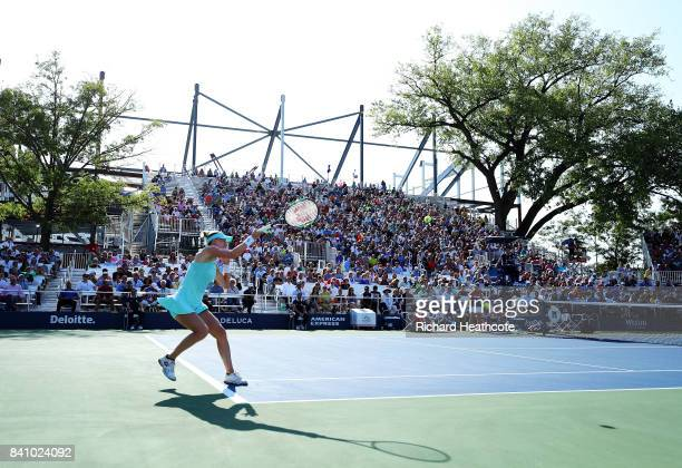 Alison Riske of the United States returns a shot against CoCo Vandeweghe of the United States during their first round Women's Singles match on Day...