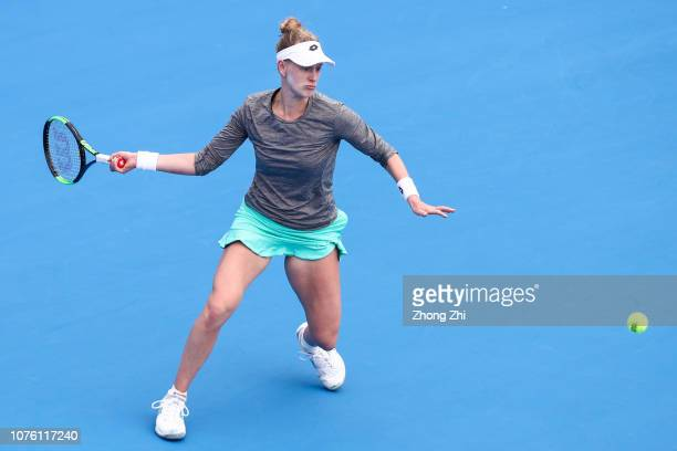 Alison Riske of the United States returns a shot against Wang Qiang of China during Day 2 of the 2019 WTA Shenzhen Open at Shenzhen Longgang Sports...