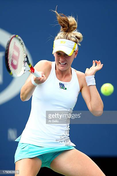Alison Riske of the United States returns a shot during her women's singles fourth round match against Daniela Hantuchova of Slovakia on Day Eight of...