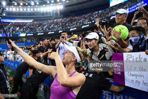 Alison Riske of the United States takes photos with fans afte the Ladies single semifinal against Petra Kvitova Day 6 of 2019 Dongfeng Motor Wuhan...