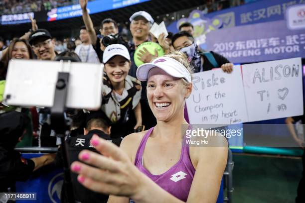 Alison Riske of the United States takes photos with fans after winning the Singles Semifinal match against Petra Kvitova of Czech on Day 6 of 2019...