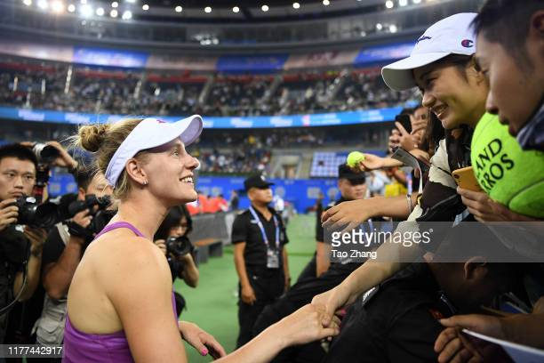 Alison Riske of the United States talks with fans after the Ladies single semifinal against Petra Kvitova Day 6 of 2019 Dongfeng Motor Wuhan Open at...