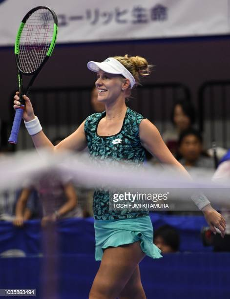 Alison Riske of the US acknowledges spectators after winning her women's singles second round tennis match against Garbine Muguruza of Spain at the...