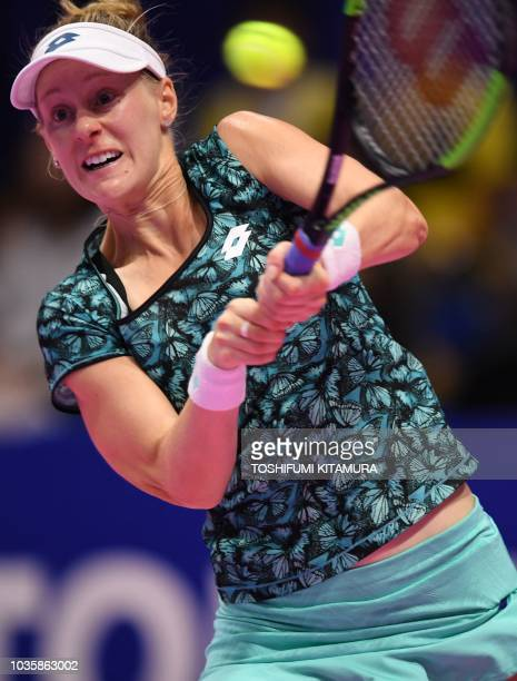 Alison Riske of the US hits a return against Garbine Muguruza of Spain during their women's singles second round tennis match at the Pan Pacific Open...