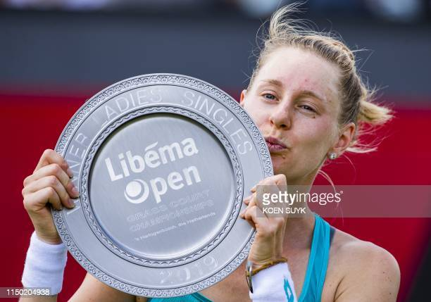 Alison Riske of the US holds her trophy after winning the women's final match against Kiki Bertens of The Netherlands of the Libema Open Rosmalen...