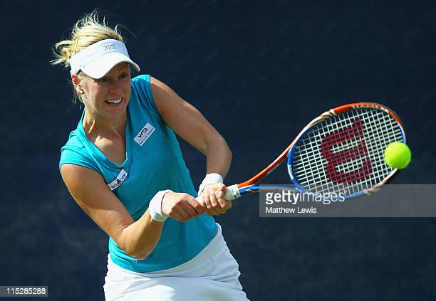 Alison Riske of the USA plays a backhand during her match against Urszula Radwanska of Poland during the first day of the AEGON Classic at the...