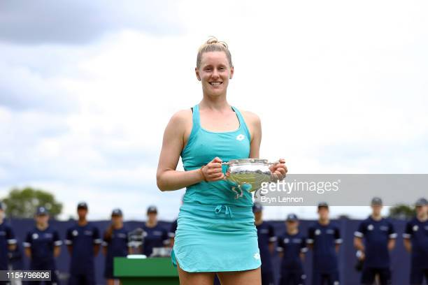 Alison Riske of the USA poses with her trophy after winning the Women's Singles Final on day seven of the Surbiton Trophy at the Surbiton Racquet...