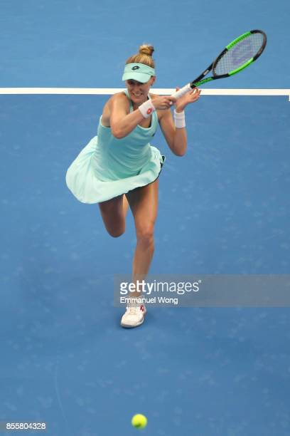 Alison Riske of the USA returns a shot against Simona Halep of Romania on day one of the 2017 China Open at the China National Tennis Centre on...