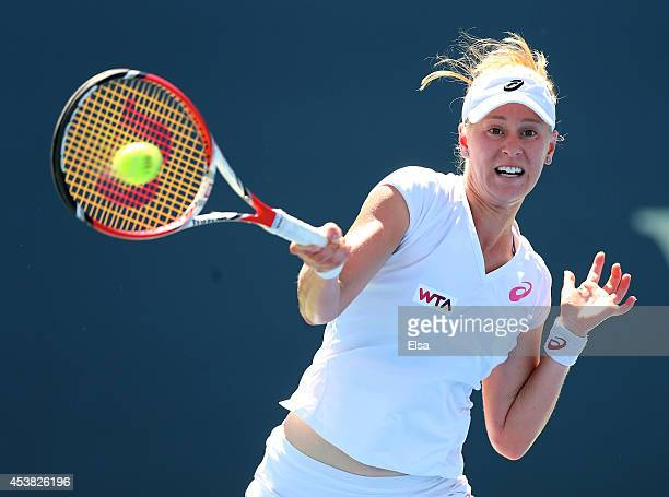 Alison Riske of the USA returns a shot to Flavia Pennetta of Italy during the Connecticut Open at the Connecticut Tennis Center at Yale on August 19...