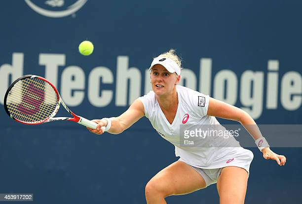 Alison Riske of the USA returns a shot to Magdalena Rybarikova of Slovakia during the Connecticut Open at the Connecticut Tennis Center at Yale on...