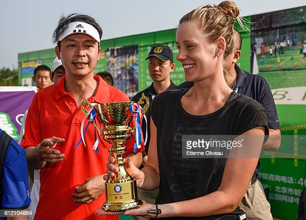 Alison Riske of United States holds a trophy during Celebrity Award event on day three of the 2016 China Open at the China National Tennis Centre on...