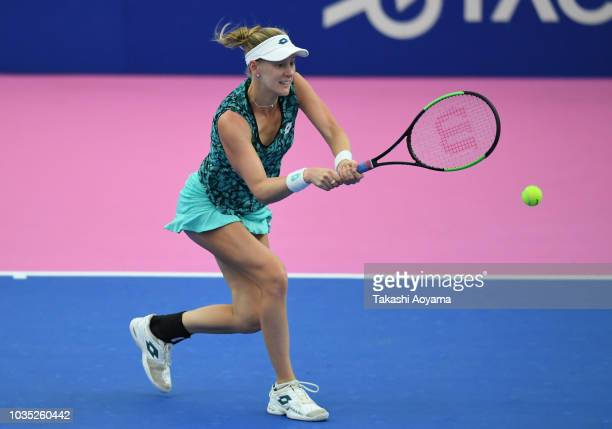Alison Riske of United States plays a backhand against Eugenie Bouchard of Canada during their WomenÕs singles first round match on day two of the...