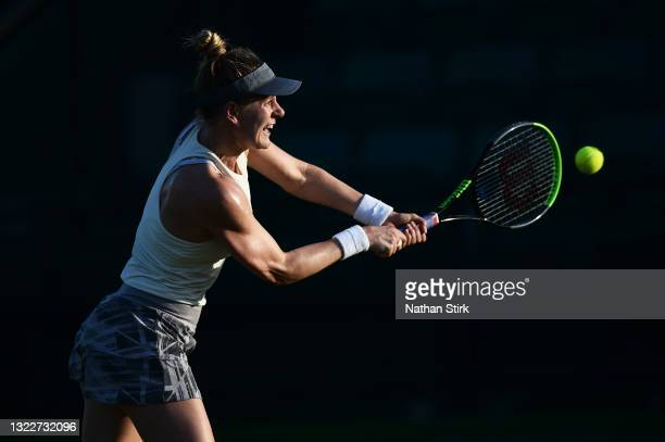 Alison Riske of United States plays a backhand shot to Xiyu Wang of China during the Women's singles on day five of the Viking Open at Nottingham...