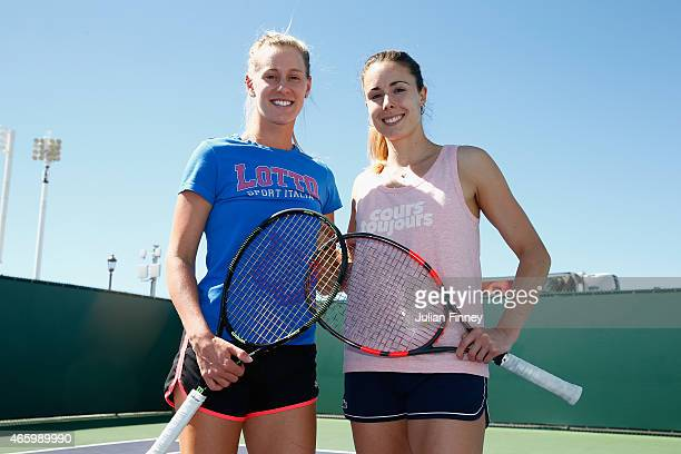 Alison Riske of USA and Alize Cornet of France pose for a photo after a kids clinic during day four of the BNP Paribas Open tennis at the Indian...